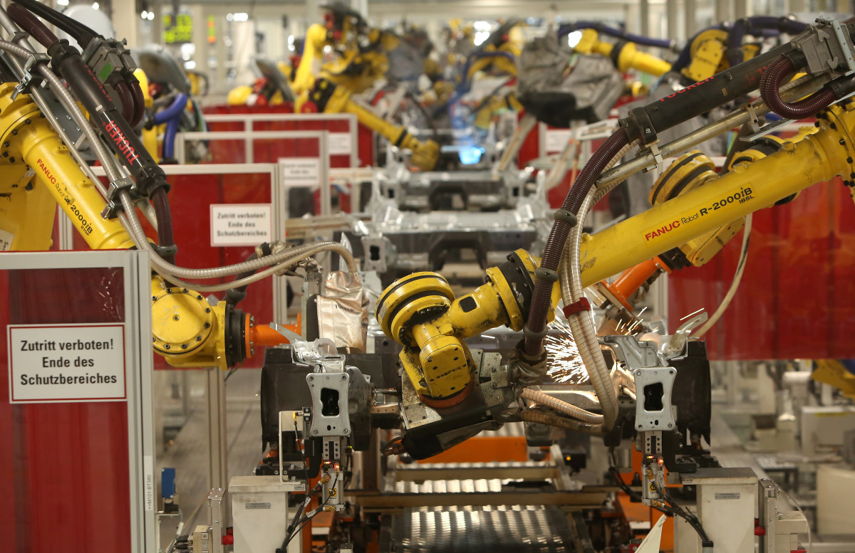 Robots assembling an automobile in Wolfsburg, Germany. Photo: Adam Berry/Getty Images